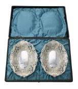A cased pair of Victorian silver shaped oval dishes by Horton & Allday
