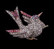 An early 20th century diamond, ruby and sapphire bird brooch