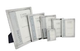 Five silver mounted rectangular photo frames by Carr's of Sheffield Ltd.