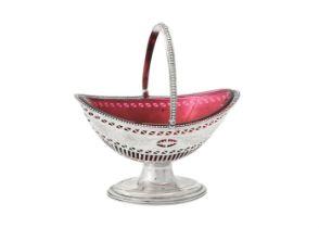 A George III silver oval swing handled basket by Solomon Hougham
