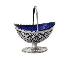 A George III silver oval pedestal sugar basket by Charles Houghman