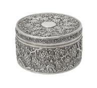 A Chinese silver circular box and cover by Wang Hing