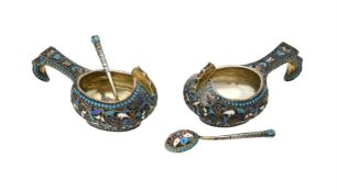 A pair of Russian silver coloured and enamel kovsh and spoons