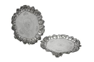 A pair of early Victorian silver shaped circular salvers by John Tapley