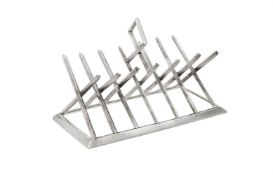 A Victorian silver six division toast rack by George Fox