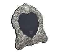 A silver mounted shaped photo frame by Carr's of Sheffield Ltd.