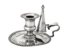 A silver chamberstick by Goldsmiths & Silversmiths Co. Ltd.