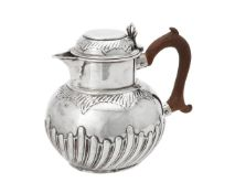 A Victorian silver half lobed circular jug by Charles Stuart Harris