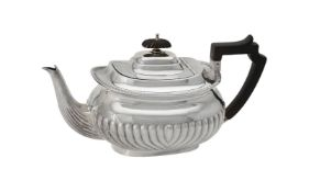 Y An Edwardian silver oblong baluster tea pot by Atkin Brothers