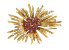 A late 1950s ruby and diamond abstract brooch by Ben Rosenfeld