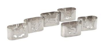 A set of six silver oval napkin rings by Sandra Poulton