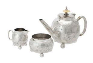 Y A Victorian silver globular three piece tea set by Charles Boyton (II)