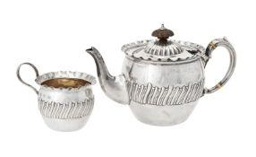 Y A Victorian silver circular tea pot and cream jug