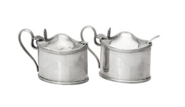 A pair of Victorian silver oval mustards by Daniel & John Wellby