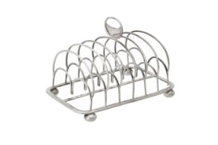 A George III silver six division toast rack by John & Henry Lias