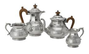 A silver matched circular baluster four piece tea set by Asprey & Co. Ltd.