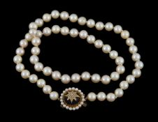 A cultured pearl necklace with amethyst clasp
