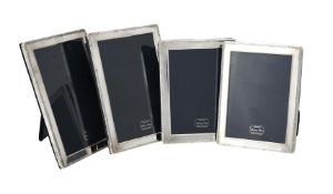 A pair of silver mounted rectangular photo frames by Kitney & Co.