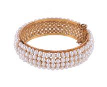 A freshwater cultured pearl hinged bangle