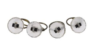 A set of four French 1930s rock crystal, onyx and diamond buttons