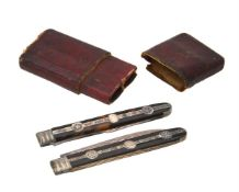 Y A cased George III silver mounted and tortoiseshell travel knife and fork