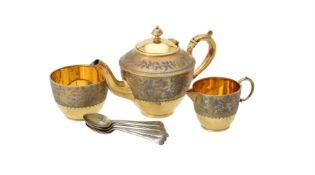 Y A cased Victorian silver gilt three piece tea set by Elkington & Co. Ltd.
