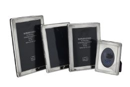 Four silver mounted rectangular photo frames by Kitney & Co.