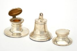 A silver bell shaped capstan inkwell
