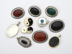 A collection of stained hardstone brooches