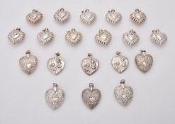 A collection of silver and silver coloured heart shaped scent bottles