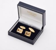 A pair of citrine and gold coloured cufflinks