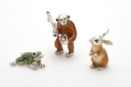 Silver and enamel models of a monkey, frog and a rabbit