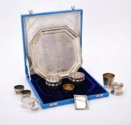 A cased silver coloured octagonal salver