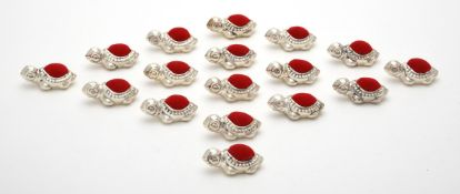 A collection of seventeen silver mounted turtle pin cushions