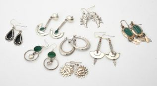 A collection of silver coloured earrings