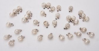 A collection of silver lobed spherical scent bottles
