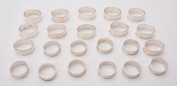 A set of ten silver circular napkin rings