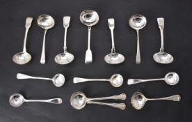 A collection of silver sauce ladles