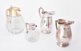 An electro-plated mounted glass jug