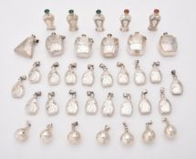 A collection of assorted silver scent bottles