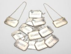 Thirteen silver octagonal decanter labels by Kitney & Co.