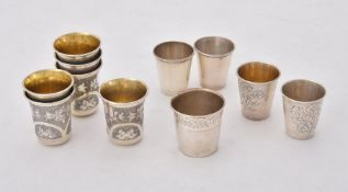 A set of six Russian silver vodka tots by Vasily Iconov