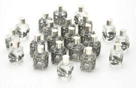 Twenty two glass scent bottles with silver coloured mounts