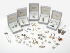 A collection of various silver and silver coloured jewellery