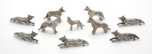 Ten assorted silver models of foxes