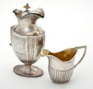 Y A Victorian silver shaped oval and fluted jug by Robert Harper
