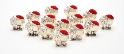 Fourteen silver mounted pin cushions