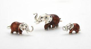 Three silver and enamel elephants