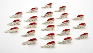 Twenty two silver shoe pin cushions