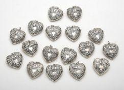 Seventeen silver heart shaped pendant boxes